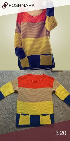 Color Block Sweater Striped color block knitted sweater with two pockets. Soft and comfortable. One size. Length: 29 in. Bust: 40 in. In my opinion, I would say it fits like a medium/large. Never been worn, perfect condition. Sweaters