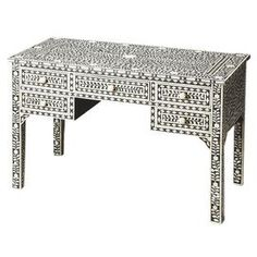"""Handcrafted desk with bone inlays in a vine motif.  Product: DeskConstruction Material: Bone veneers, MDF and resinColor: Black and creamFeatures:  Light distressingHandcrafted Dimensions: 33"""" H x 50"""" W x 24"""" DCleaning and Care: Wipe with a soft dry or slightly dampened cloth"""