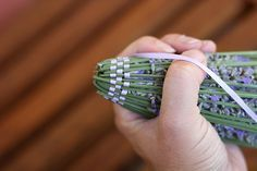 Lavendar wand - tie 15-30 lavendar blooms at the bottom of the bloom.  Then flip the stems over the blooms and begin to weave ribbon in between the stems...