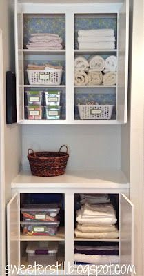 Scrapbook paper on the back of the cabinet walls - love!