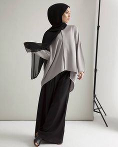 Achieve sophistication in a modest and comfortable ensemble. Dove Batwing Shirt with Dipped Hem Black Pleat Front Palazzos www.inayah.co