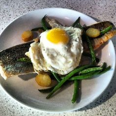 Trout amondine with an egg, potatoes and green beans