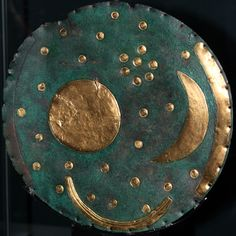 """The Nebra Sky disk (featuring The Pleiades); Mittelberg near Nebra (Germany), ca. 1600 BC.; Special exhibition """"Beyond the Horizon - Space and Knowledge in the Old World cultures"""" at the Pergamon Museum (22.06 -. 30.09.2012)"""