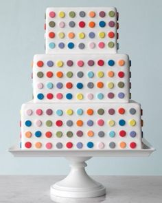 "See the ""Britart Wedding Cake"" in our  gallery This offbeat number -- perfect for a contemporary wedding where fun is the focus -- mirrors the artist's vivid grids of circles set against white canvas. Assistant food editor Elizabeth Colling punched out multicolored fondant dots using a round pastry tip and attached them to a white-fondant cake using a gum-paste solution."