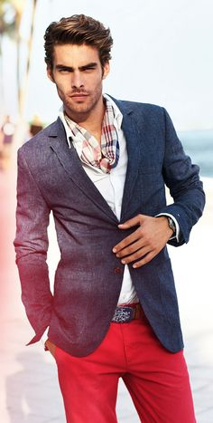 Color that works. Red trousers worn with white and blue, the checked scarf ties everything together. Men's style.