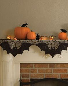 Simple orange and black Halloween decor for a fireplace mantel