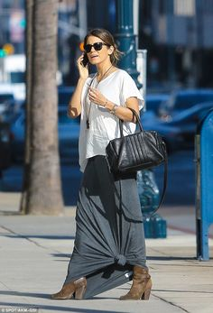Tied up: Nikki Reed stepped out in Beverly Hills wearing a knotted grey skirt on Wednesday...