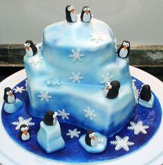 Iceberg Penguin Cake - For all your cake decorating supplies, please visit craftcompany.co.uk