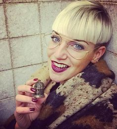 OMG, she is so gorgeous! Two-tone bowl cut, aviator glasses, perfect makeup.  #hairdare