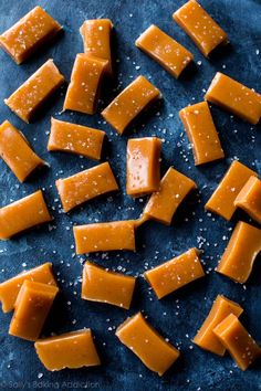 Super soft and chewy sea salt caramels loaded with delicious vanilla bean! Step by step recipe on sallysbakingaddiction.com