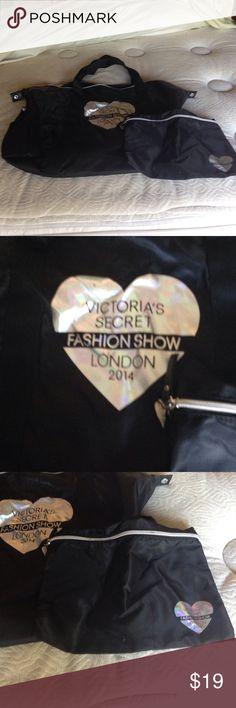 Victoria's Secret Fashion Show London 2014 tote VS Fashion Show London 2014 gym tote and corresponding cover bag. Black with logo on the front, plain black on the back. Glossy nylon. Victoria's Secret Bags Totes