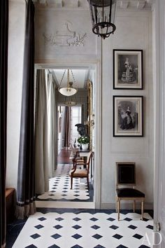 Curtained in a Romo velvet, the light-filled entrance hall  of an American couple's Paris home was renovated and decorated by Jean-Louis Deniot.