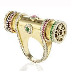 "Sybarite Jewellery   ""This is the fully functioning Kaleidoscope ring, it has rubies, sapphires and emeralds inside that move when you turn it. It's actually going to be expanded into a full collection and we're in the middle of making a beautiful diamond version."""