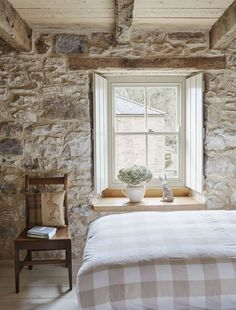 Stone house bedroom.  Deep window sills and neutral, calm color