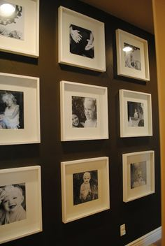 Photo wall using  9 of the Ribba frames from IKEA.  Easy to change out the pictures when you want to update the wall, and good for filling a large space with wall art on a budget.