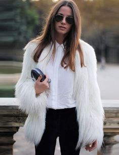Mid length faux fur coat that will keep you warm and look stunning at the same time!