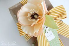 DIY crepe paper poppy - place on gifts or make a bouquet::Jones Design Company (includes link to template for petals) Creative Gift Wrapping, Creative Gifts, Wrapping Ideas, Making A Bouquet, Flower Making, Jones Design Company, Tissue Paper Flowers, Flower Paper, Gift Ribbon