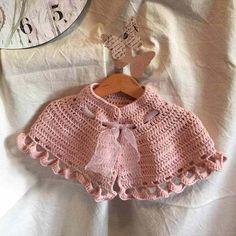 The shawl crochet is designed for an important event for a girl, for their first communion, with this as romantic as it offers the pink color Crochet Baby Cardigan, Baby Girl Crochet, Crochet For Kids, Crochet Shawl, Crochet Yarn, Free Crochet, Crochet Needles, Crochet Stitches, Single Crochet