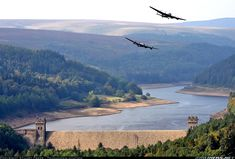 A once in a lifetime sight most likely never to be repeated again. The last two airworthy Avro Lancasters fly over Derwent Dam re-creating the famous Dambusters raid where it was practised.