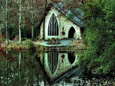 little cottage in the woods...how glorious that cathedral window must look from the inside...