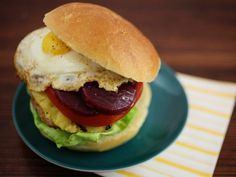 When sambal oelek — a sweet, spicy and salty Asian chili paste — is mixed into the patties of these chicken burgers, they take on Asian flavors prevalent throughout much Australian cooking. But it's the pineapple rings, pickled beets and sunny-side-up egg that make this burger uniquely Australian.
