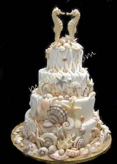 Custom Sugar Art Seashells  Beautiful work by Ms Debbie.  She made the pieces much like this for our wedding cake.  Packed well enough to carry all the way to Antigua.  People continue to rave about our cake a year later. Can't thank her enough!!!