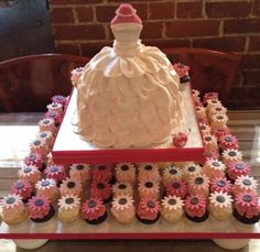 So cute!  Pink dress and little cupcakes!!  would be cutter with the doll pick. (This is what I am doing for the shower)