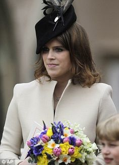 Eugenie looked a picture of elegance - and showed off her increasingly svelte frame - as she accepted flowers from well-wishers and didn't seem to mind that her elder sister Beatrice was not there to lend a hand.