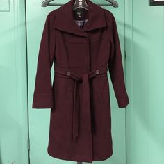 """MOSSIMO BURGUNDY WOOL BLEND TRENCH STYLE COAT Rich Burgundy Wine color wool blend coat with trench style lines and belt at waist and hidden front pockets and snap closures for sleek hidden look. Nice warm coat of 72 wool  20% Nylon and 8% other fibers. Armpit to Armpit: 18 inches shoulder to bottom: 37""""inches  sleeve length:24 inches  in excellent condition ❤️ Mossimo Supply Co. Jackets & Coats"""