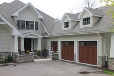 These Garage Doors May Look Like Wood But They Are Actually Stained Steel  And Composite,
