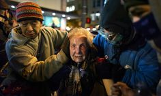 Occupy activist Dorli Rainey, 84, after being hit with pepper spray during a protest in Seattle. Photograph: Joshua Trujillo/AP