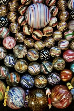 German Marble Beads | One of the photos from Jack DeWitt beautiful series of old bead. Many of the photographs are beads and bead sample cards from the collection of John and Ruth Picard and can be seen at their bead museum in Carmel Valley California. | Jack offers these bead photo either as a blank cards with envelope, or some are also available as striking enlargements