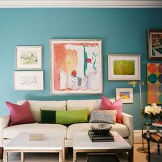 light floor and furnishing,bright pops of color in art and pillows.