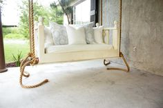Porch swinging just got a little sweeter! This simple elegant swing will spruce up any porch just in time for summer! The plans are centered around using a crib mattress as the cushion, so grab a crib sheet and some pillows and you have a cozy bed swing to relax in all year long!