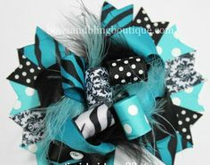 "I love this super cute turquoise and black hair bow! The bow is layered with vibrant colors and beautiful ribbon. Each bow pictured measures approximately 5""-5.5"" across. It is perfect for babies, tod"