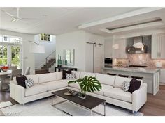 Open floor plan family room, kitchen and dining area | Jumby Bay in Olde Naples, Florida