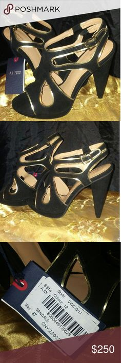 Armani women's heels Black suede trimmed in metallic gold heels are three perfect start to a night on the town. These are leather lined and have a 4 1/2 inch cone shaped heel that is suede just like the upper part of the shoe. The cut outs and open toe lined with gold speak for themselves! These are new with tag still attached, however, original packaging is not available. Armani Jeans Shoes Heels