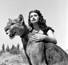 "An actress and a panther on the set of ""Prehistoric Woman."" Photograph by Allan Grant. California, May Strength Tarot, Ethereal Beauty, Queen Mary, Wild And Free, Endangered Species, Prehistoric, Panther, Pin Up, My Arts"