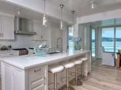 """Driftwood"" flooring + whitewashed walls = beach chic cuisine. #kitchen #stools #backsplash"