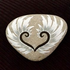 Angel wings on a pebble....