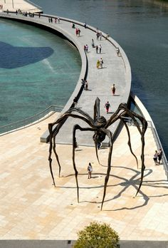 Basque Country, Bizkaia, Bilbao, Guggenheim Museum - Maman (1999) is a sculpture by the artist Louise Bourgeois. The sculpture, which resembles a spider, is amongst the world's largest, measuring over 30 ft high and over 33 ft wide, with a sac containing 26 marble eggs. Its abdomen and thorax are made up of ribbed bronze.