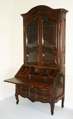 """Very fine, French provincial, Louis XV period secretaire en bibliotheque. From Southwestern France bearing the """"Croix de Malte"""" in marquetry and with chapeau de gendarme cornice and arbalette façade on the drawers of the bottom compartment. Mid-18th century. 1stdibs - Pair of Louis XVIth """"Chapeau de gendarme"""" Armchairs explore items from 1,700 global dealers at 1stdibs.com"""