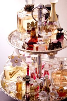 cake stand full of perfume bottles!- YES! Need this for me and my 38 perfume bottles! haha