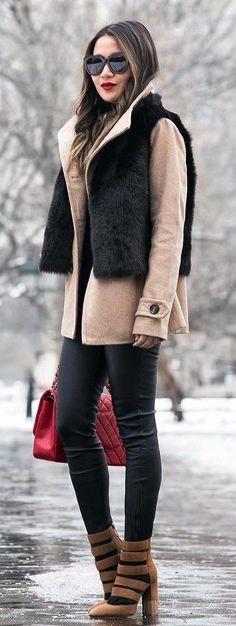 #winter #fashion / Black Faux Fur Vest / Camel Jacket / Black Skinny Jeans / Brown Bandage Booties