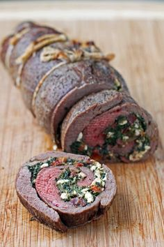 This Spinach and Feta Stuffed Flank Steak is a perfect meal for company - it looks fancy but it's a surprisingly easy recipe! Just 372 calories or 9 Weight Watchers points per serving. www.emilybites.com