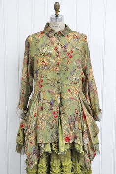 "Features: Lovely shirt Can be worn as a shirt or jacket Handkerchief hem Side ties for a fitted look 100% Graphic Cotton Voile, Tea Leaf Chinese Ladies Fits Sizes 2-18 Measurements: Chest: about 51"" around Length: about 38"" at longest point"