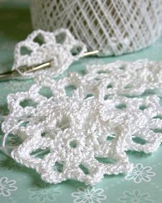 Easy peasy pattern.   Turns out very cute.   Crochet snowflakes