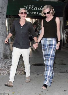 Check them out: While Ellen, 57, opted for a simple pair of cream jeans, a navy shirt and ...