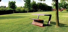 Bench-table made from shaping a single laser cut sheet, purposefully reinforced. The bench is modular and is ideal for picnic areas or public parks. It's available in three sizes and can be equipped with a seat in teak wood.