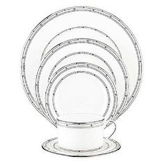 """Kate Spade Pebble Point Dinner Plate by Lenox. $34.99. Made by Lenox. Kate Spade Artistry, Lenox Craftsmanship. Two iconic brands, one exceptional product line.. Crafted of Lenox bone china accented with precious platinum. Each piece of this china place setting is decorated with dots and platinum banding. Diameter of dinner plate: 10 3/4"""", salad plate: 8"""", bread plate: 6 1/3"""", saucer: 5 1/2""""; capacity of cup: 7 oz.. Dishwasher Safe. Wit and elegance are hallmarks..."""
